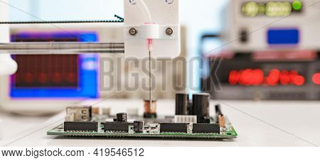 Debugging electronics device. PCB witch microcontroller in electronics laboratory. High quality photo