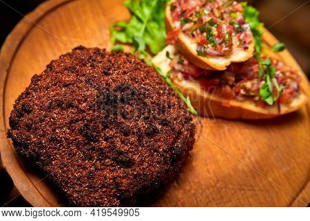 Veal Steak Breaded With Spices With Tomato Salsa