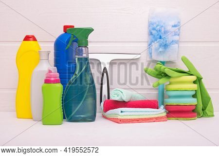 Colored Rags, Gloves And Detergents For Cleaning The House On A White Background