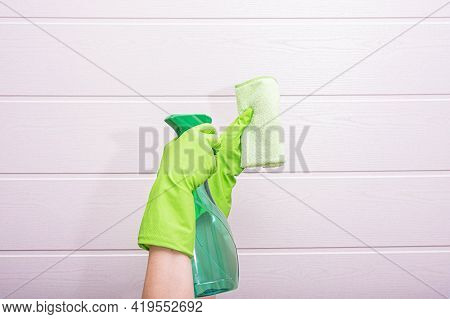 Woman In Gloves Holds Detergent And A Rag For Cleaning In The Bathroom, On A White Background