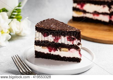 Raspberry Cake With Chocolate. Chocolate Cake With Berries. Piece Of Cake On A Plate. Dessert On Whi