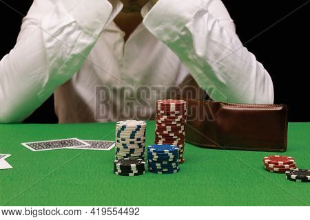 Unfortunate Young Man Feeling Sad, Desperate And Stressed After Losing His Money Playing Poker And B