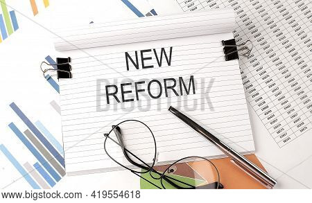 New Reform Text On Chart , Office Supplies, Business Concept