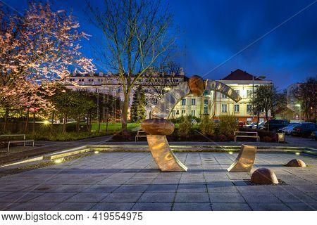 Pruszcz Gdanski, Poland - May 3, 2021:  Amber sculpture in Pruszcz Gda?ski at dusk, Pomerania. Poland