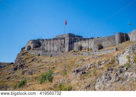 View On Main Buildings Of Kars Castle, Kars, Turkey. Citadel Located On Unattackable Rock, Surrounde