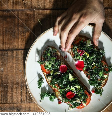 Woman eating kale toast for lunch