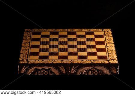 An Empty Chessboard With No Chess Pieces On A Black Background