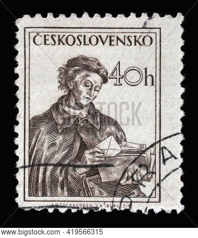 ZAGREB, CROATIA - SEPTEMBER 18, 2014: Stamp printed in Czechoslovakia shows Post woman, Professions series, circa 1954