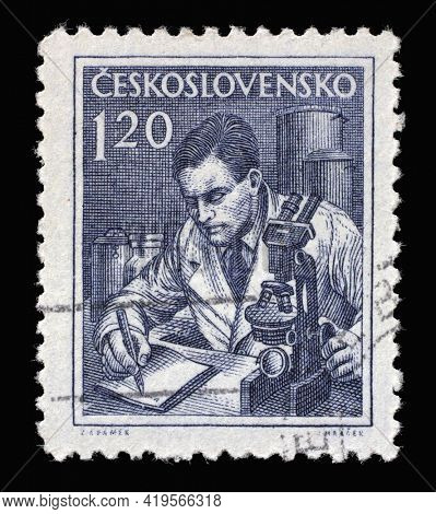 ZAGREB, CROATIA - SEPTEMBER 18, 2014: Stamp printed in Czechoslovakia shows Scientist, Professions series, circa 1954