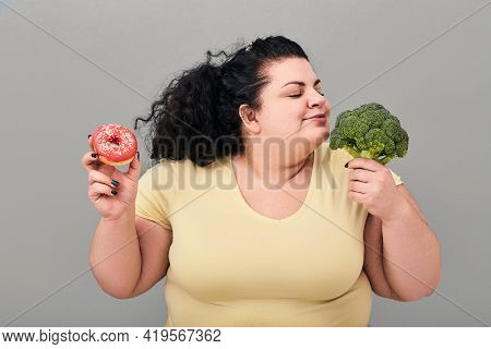 Overweight Woman Chooses Healthy Food For Right Nutrition And Weight Loss. Diet Concept