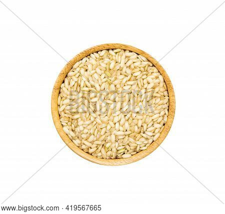 Medium Grained Rice Heap In Wooden Brown Bowl Isolated On White Background, Top View. Unpolished Org