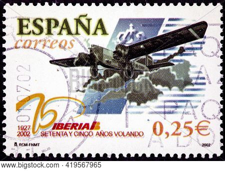 Spain - Circa 2002: A Stamp Printed In The Spain Shows An Old Plane Flying Commemorating The 75th An