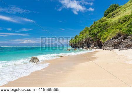 Beautiful Melasti Beach, Bali, Indonesia. Seascape With A Mountain In The Background. Selective Focu
