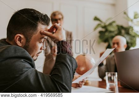 Stressed businessman in a meeting