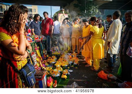 KUALA LUMPUR - JANUARY 27: Hindu devotees perform prayers on the milk pots before the procession to the Batu Caves temple on January 27, 2013 during the Thaipusam festival in Kuala Lumpur, Malaysia.