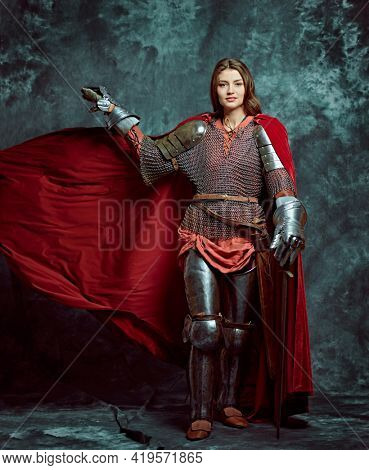 Full length portrait of a beautiful female knight in armor of noble birth. History of the Middle Ages.