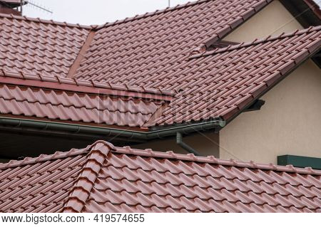brown tile roof with gutters, house element, roof waterproofing