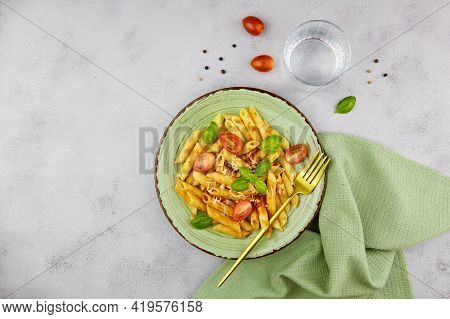 Classic Italian Pasta Penne With Tomatoes, Cheese And Basil On Grey Background. Top View With Copy S