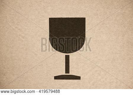 Fragile Symbol (wine Glass) On Cardboard. Close Up