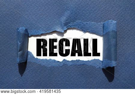 Recall. Text Inside Torn Paper. White Sheet With Black Font.