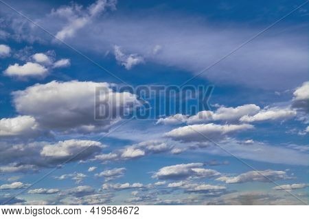 White Fluffy Clouds In The Blue Sky. Blue Summer Sky With White Cumulus Clouds.