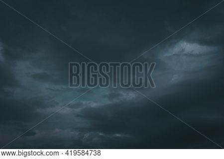Picture Of Thunderstorm Clouds Starting To Pour Rain And Lightning