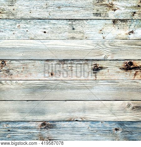 Rustic Table Built With Planks Of Aged Light Wood. Abstract Background.