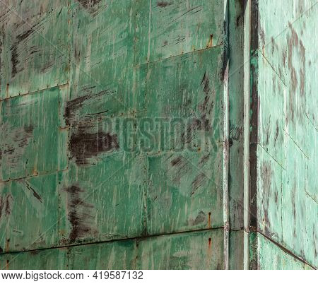 Background Of Oxidized, Rusted Sheets Of Green Metal For Texture And Background