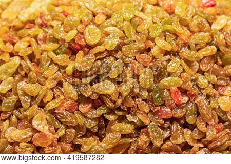 A Heap Of Yellow Raisins For Background (selective Focus)
