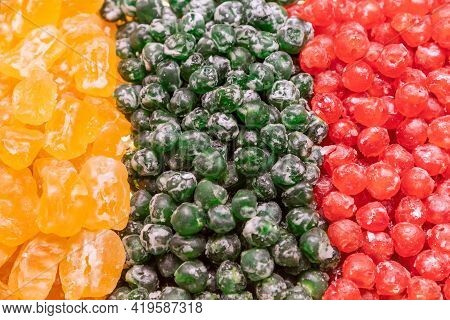 Tricolor Composition Of Candied Cherries And Apricots Yellow, Green And Red Colors