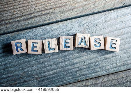 Release Written On Wooden Blocks On A Board