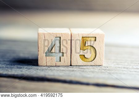 Number 45 Formed By Wooden Blocks On A Board