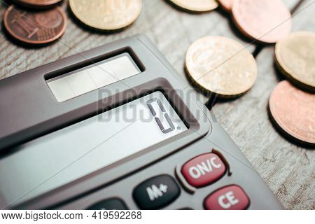 Calculator And Euro Coins On A Wooden Board - Save Money Concept
