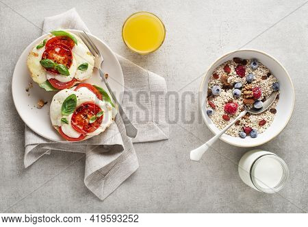 Breakfast Served With Oatmeal And Fruits, Mozzarella Sandwich And Juice On Table Top View. Healthy B