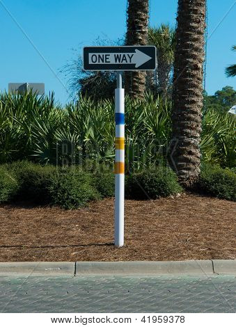 sign for a residential area, on the background of palm trees