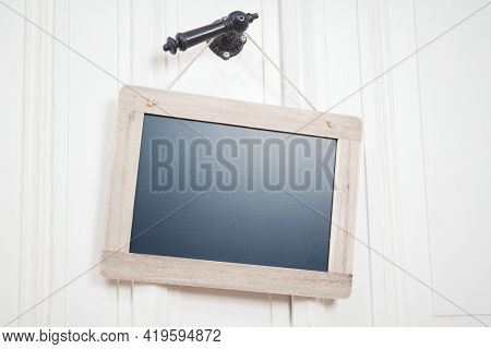 Blank Blackboard With Copy Space On A String Hanging On A Doorhandle
