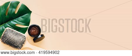 Hair Care Concept. Wooden Hair Brush And Natural Hair Mask Lie On Beige Background. Spa Hair Care. B