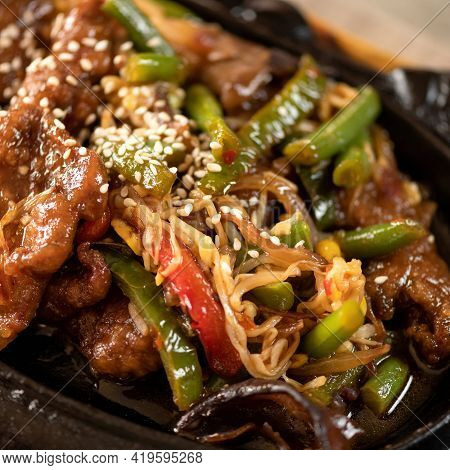Colorful Appetizing Wok Noodles Dish With Sesame Seeds And Vegetables. Oriental Dish, Pan-asian Cuis