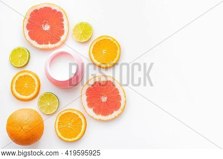 Cream And Citrus Fruits . Skin Care. Citrus-based Cream. White Background. Copy Space