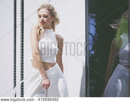 Glamurous Female Fashion Model Presenting Casual Elegant Outfit. Woman Wearing Crop Top. Summer Urba