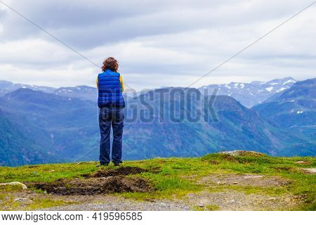 Tourism Vacation And Travel. Woman Enjoying Scenic Summer Mountains Landscape From Vedahaugane Looko