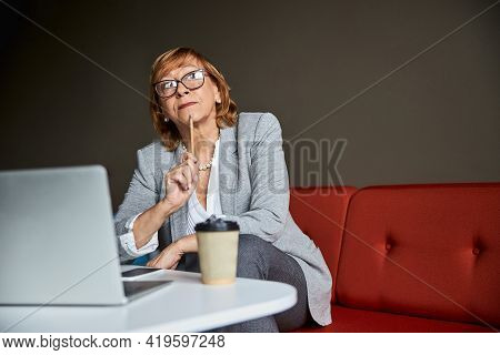 Cute Mature Woman Thinking About Her Plans