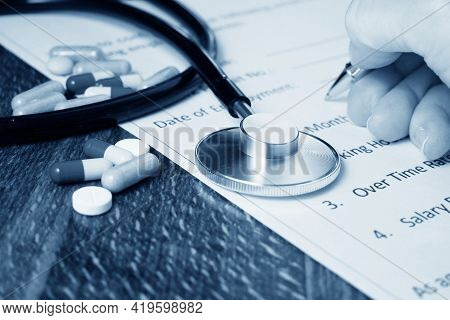 Pills And Stethoscope And Hand Signs The Medical Insurance, Insurance Agent Holding Pen Medical Insu