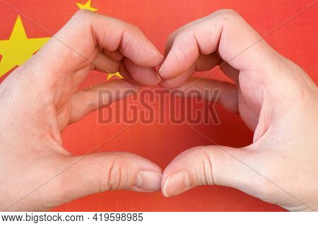 I Love China. Hands Make Heart Pn American Flag Background. People's Republic Of China Day October 1