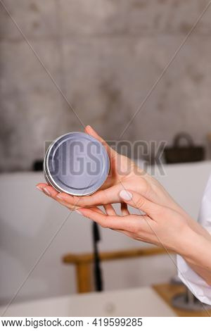 Woman Holding Botle Or Jar For Spa Cosmetics Purpose In Bathroom. Beauty Blogger, Salon Therapy, Min