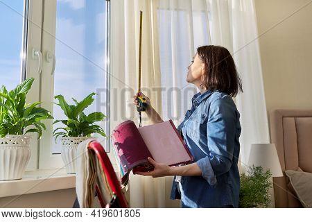 Female Designer Choosing Curtain Fabrics, Measuring Window With Tape Measure