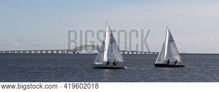 Babylon, New York, Usa - 7 December 2019: Two Sailboats Sailing In The Great South Bay On A Winter A
