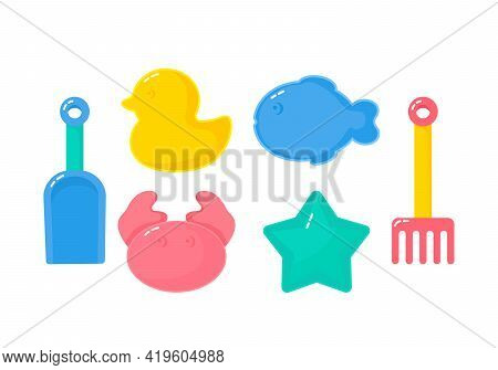 A Set Of Children's Toys And Sand Molds With A Children's Shovel And Rake. Concept Of Childrens Rest
