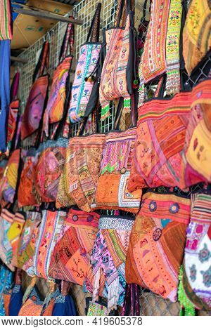 Handmade Souvenir Bags Asian Style Are Hung And Display For Sales In The Shop