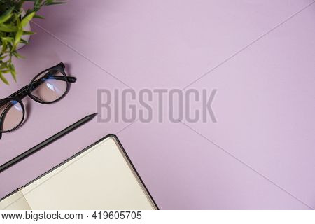 Office Supplies In The Pinc Color Workspace